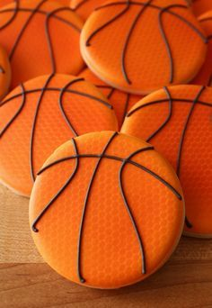 Basketball cookies capture the texture of the orange part of the ball by using orange netting. Brilliant dea and something I have been trying to trouble shoot myself. Now I won't have to!