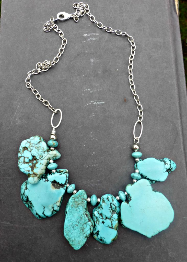 Chunky turquoise howlite stone slices that are made into a one layered necklace. With silver metal, chain and clasp. Necklace is lightweight and currently measures 23 inches around in length, this nec