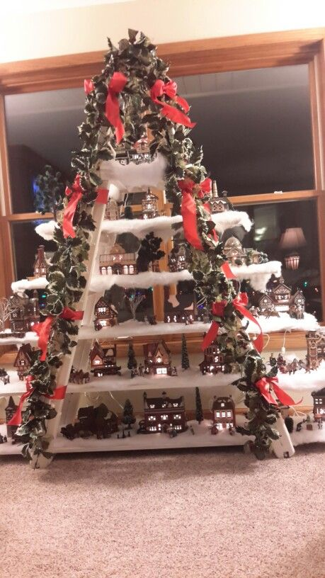 Dicken's Christmas village display using our pool ladder, a few shelving boards and some craft items to dress it up.