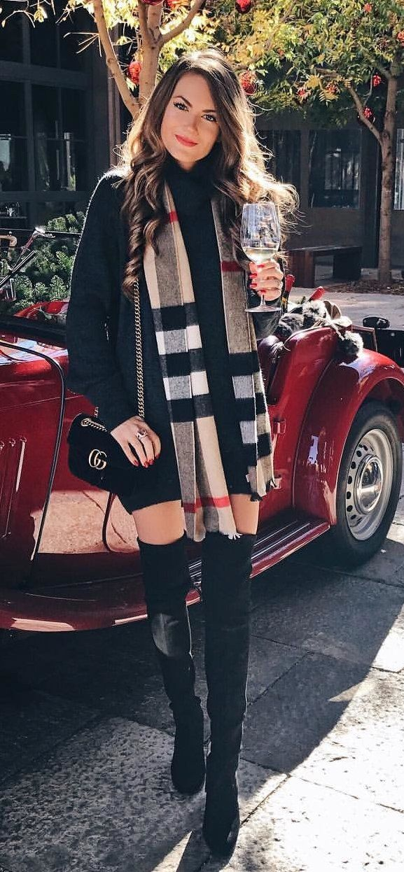 #winter #outfits women's Burberry scarf, black long-sleeved dress. Click To Shop This Look.
