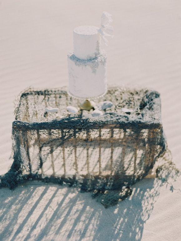 Elegant, wintry beach wedding cake designed by Maggie Austin