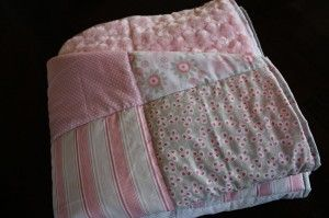 Easy crib/toddler quilt tutorial using 8 fat quarters, batting, and minky backing.
