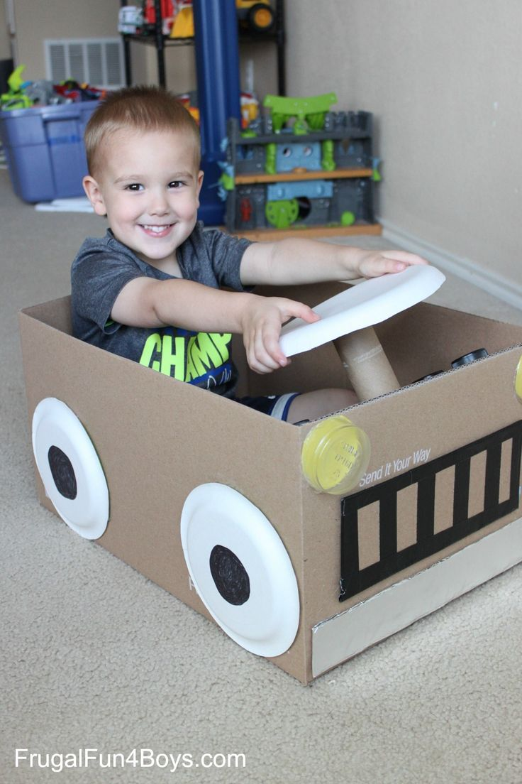 cardboard box car with a steering wheel that turns