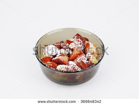 Sliced strawberries with powdered sugar