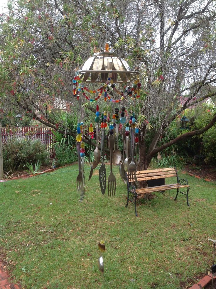 Created my own wind chime slash chandelier from items out of the opportunity shop, forks, spoons, cake server and an old silver dish. I used fishing line and glass beads.