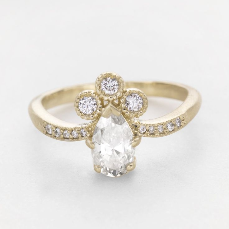 Vintage pear diamond halo engagement ring set in 14k gold. Our Josephine ring is an extraordinary example of a unique vintage halo engagement ring. Let us help you design the perfect vintage inspired engagement ring. // roughluxejewelry.com