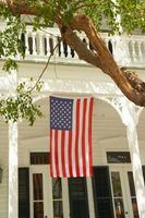 An American flag hung as a banner, with the stripes running vertically.