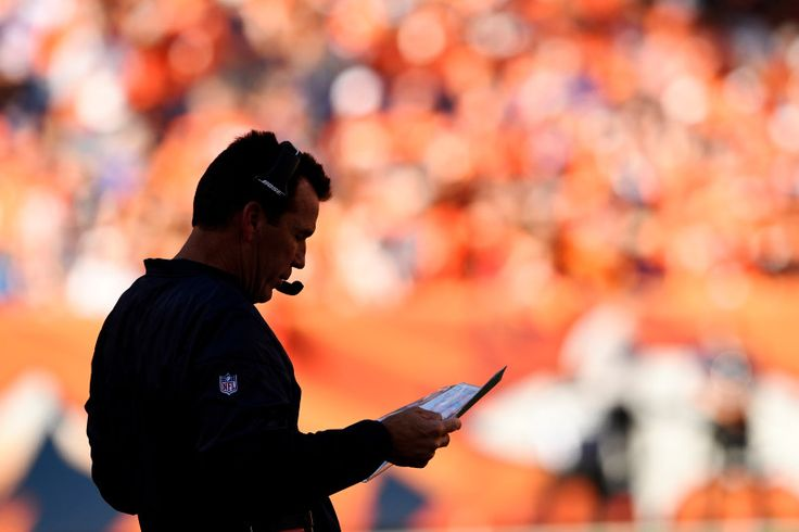 Head coach Gary Kubiak of the Denver Broncos looks at his plays against the Indianapolis Colts during the first quarter. The Denver Broncos hosted the Indianapolis Colts on Sunday, September 18, 2016. Joe Amon, The Denver Post