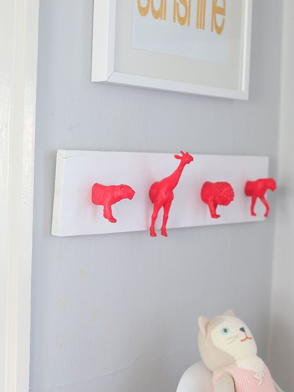Bold colors always make an impact in any space, but when neons are paired with a neutral palette, the result is amazing! | Neon Animal Hooks | Neon Pink Nursery | Liz Stanley and Isabelle Ambler via Say Yes