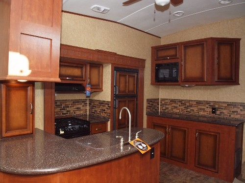 Solid surface countertops inside a 2012 Greystone 33QS Fifth Wheel.