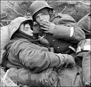 Young replacements huddle in a foxhole on the Russian Front in early 1942--now out of the Hitler Youth and in the German Army--and soon to f...