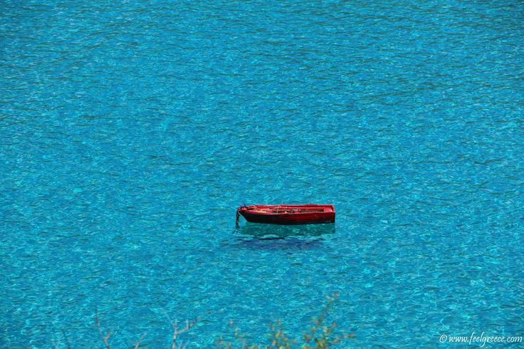 Lonely boat in the sea; photo from Diros Caves, Mani Region