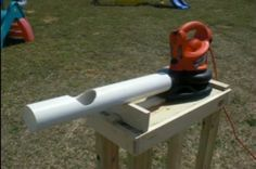 Home made pitching machine for kids. Don't forget to build a batting cage or get some protective netting!