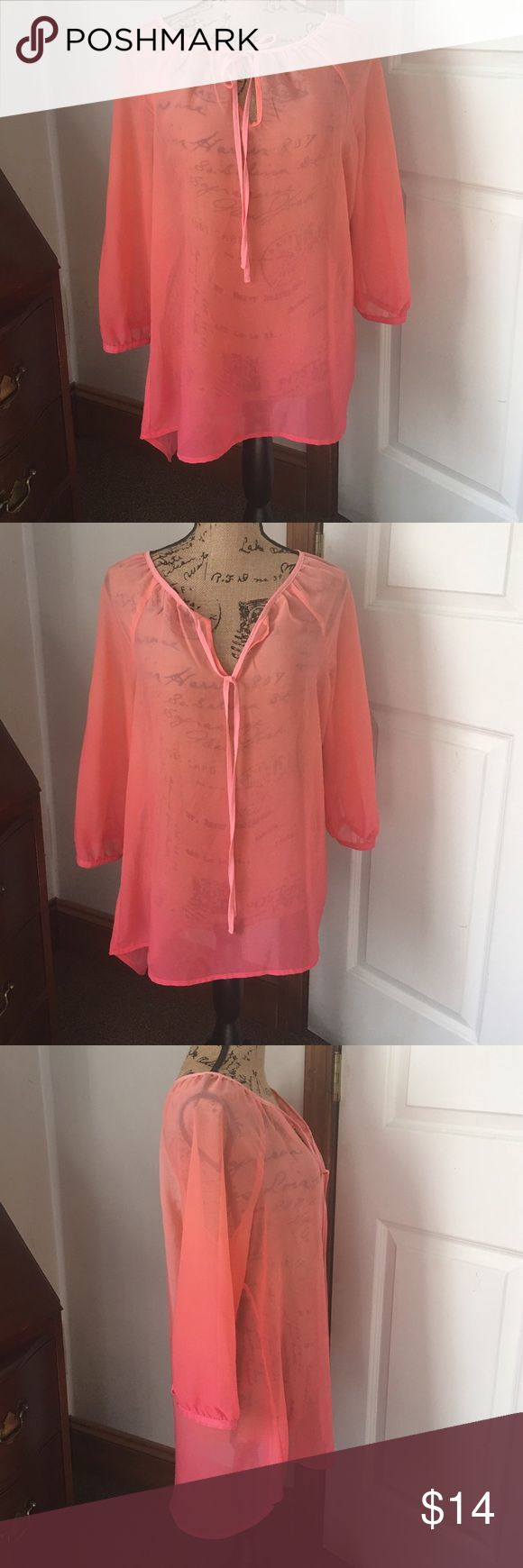 NWT A.N.A Coral Blouse New with tag-A.N.A coral blouse. Sheer blouse with button sleeves. The front allows you to tie the strings or leave untied to reveal your cami choice. A.N.A Tops Blouses