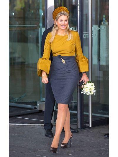 Door de hoge taille van de rok lijkt het bovenlichaam heel kort. Door het hoge contrast tussen rok en bloes lijkt de taille dikker. En door de wijde mouwen lijken de heupen breder.