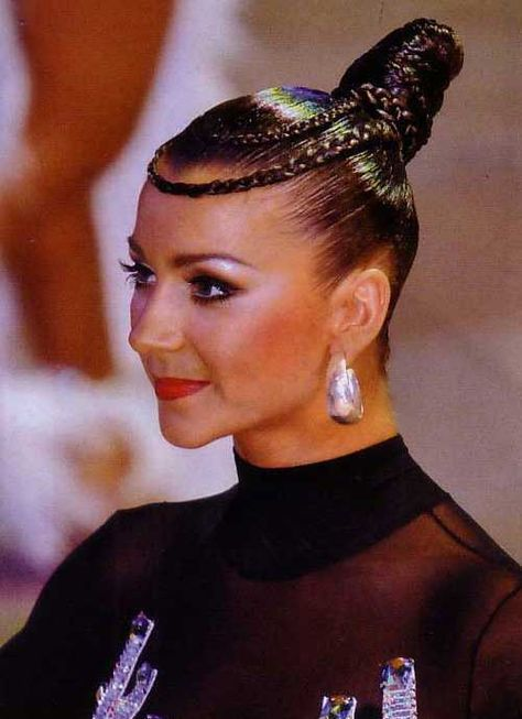 High knot bun with braided loops across the forehead. Good hairstyle for latin. Visit http://ballroomguide.com/comp/hair_make_up.html for more hair and makeup info
