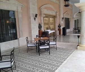 Cement Tile Border Pattern Creates Cozy Patio Dining for Italian Restaurant