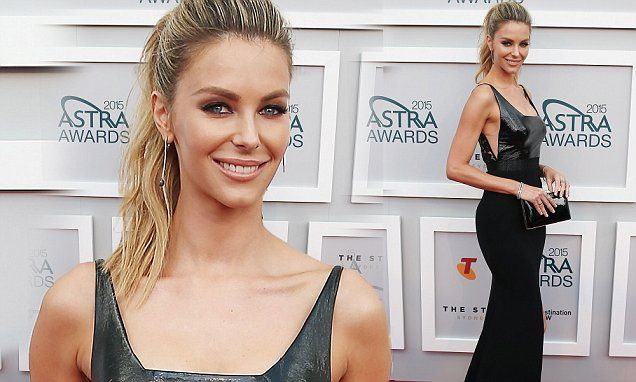 Jennifer Hawkins is naughty and nice in a floor length gown