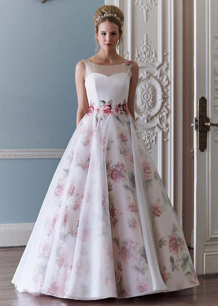 We are such a big fan of this gown by Sassi Holford for so many reasons. It is a true English rose design and we love the organza overlay and stunning shoulder detail. For any bride having a country garden wedding, this has to be your dress.