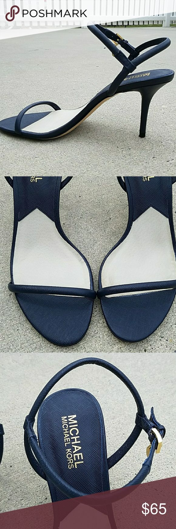 """Michael Kors Navy Blue Sandals Heels Sexy heels from Michael Kors. Navy Blue with adjustable buckle strap. Has the MK gold emblem that dangles from the strap. Great used condition. About a 3"""" heel. Michael Kors Shoes Sandals"""