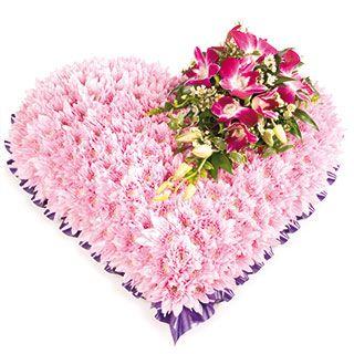 Pink Massed Solid Funeral Heart Arrangement