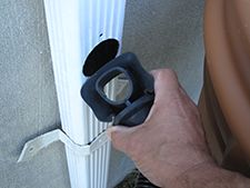 Aquabarrel Rain Barrel Diverter.  Ingenious.  Don't cut out a chunk of your downspout, just a hole, then pop in the rubber diverter... brilliant.