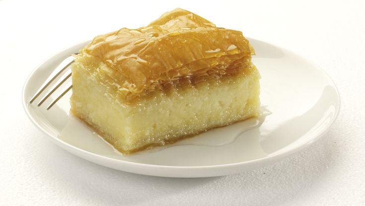 of custard baked between layers of phyllo, and then soaked with lemon ...
