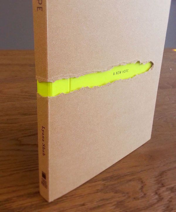 The whole project started from basic -design, print, bind, mount, fold & tear! All manual work.The title - The New Hope was printed on the neon color paper. Kraft paper wrapped over it with manually tear out revealing the title.