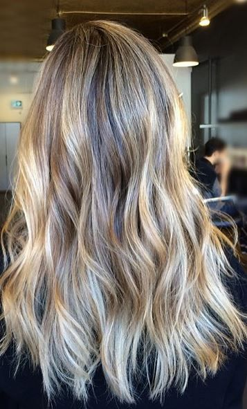 A natural shade of blonde with mid toned beige shades. Color by Somboun June. More
