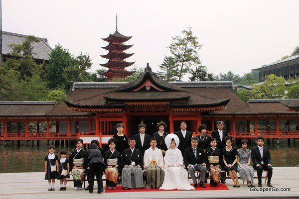 """""""Shinzen Shiki"""" Traditional Japanese weddings are usually held at a Shinto shrine (as seen in the background)."""