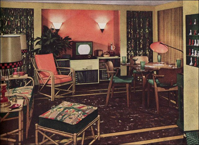 Coral, dark green, gray, and maroon were a few of the favorite colors that popped up regularly during the early 1950s. This green, coral, and buff scheme has the linoleum floor, bamboo furniture, and barkcloth upholstery and drapes that we associate with the mid century.