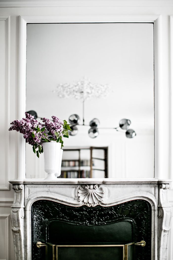 If you love the classic French style then you'll adore this striking Paris home which blends modern