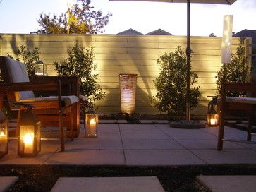 2. Warm up a look with candles and solar lights. Enhance the ambience at night by setting out lanterns filled with votive or battery-operated candles, solar garden lights and string lights. Try surrounding your seating area with lights, light up the pathway or place lights in the landscaping along a fence line.