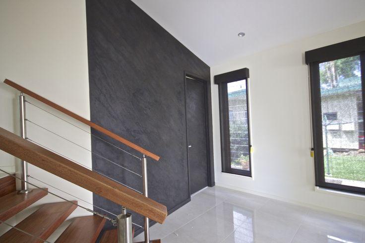 Marmorino polished plaster, charcoal stone finish.