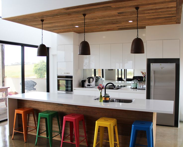Ultra White Createc doors, Caesarstone Snow Benchtops with feature recycled floor boards as the back panel