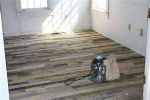 wood pallet floor - use Driftwood Weathering Wood Finish to turn them gray.