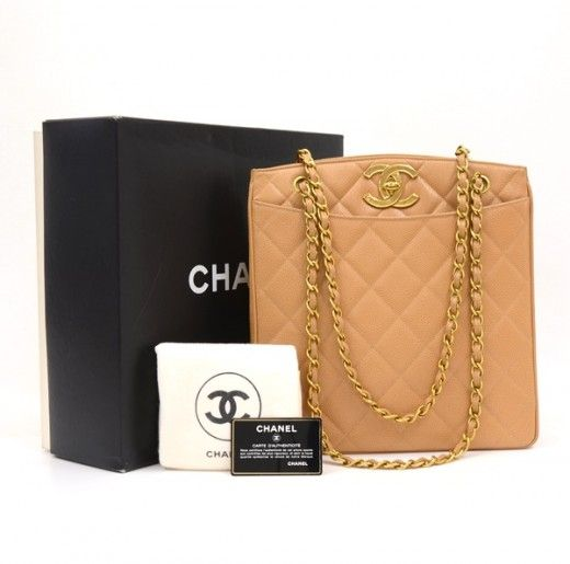 Authentic Chanel shoulder bag in beige leather. Outside has 2 open pockets on each side. Top area has CC Twist lock closure. Inside has 2 zipper pockets. This is very popular design hard to find. #Chanel #Handbag @fmasarovic