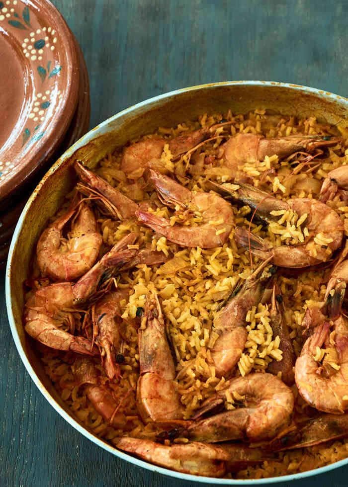 Mexican curried rice with shrimp cooked paella style. It will become a weeknight favorite.