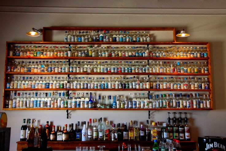 "One of the largest selection of tsipouro and ouzo  (if not the biggest one) is Greece. Pausiponon, aka ""pain killer"", taverna in Sykia."