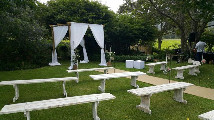 Bridal Arch and white wooden benches used in this Lovely Garden Wedding Ceremony Set up. By ISP Group.   www.ispgroup.co.za