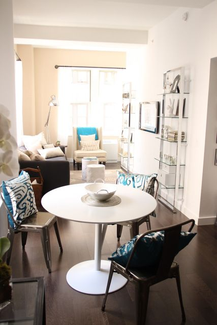 tesso bookcases and an odyssey table in the NYC Metrolofts' house tour | AT