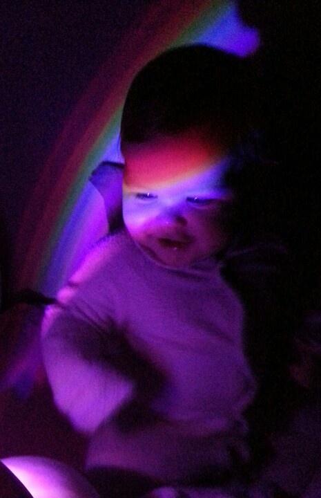 Ella in a rainbow