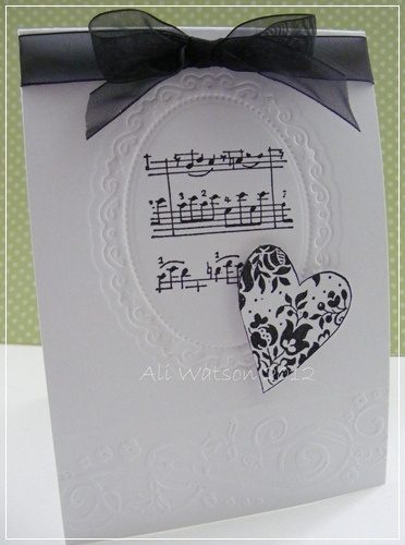 This is very pretty, but I'd prefer it with a greeting in the oval die cut. Either way, it's lovely. And classy.