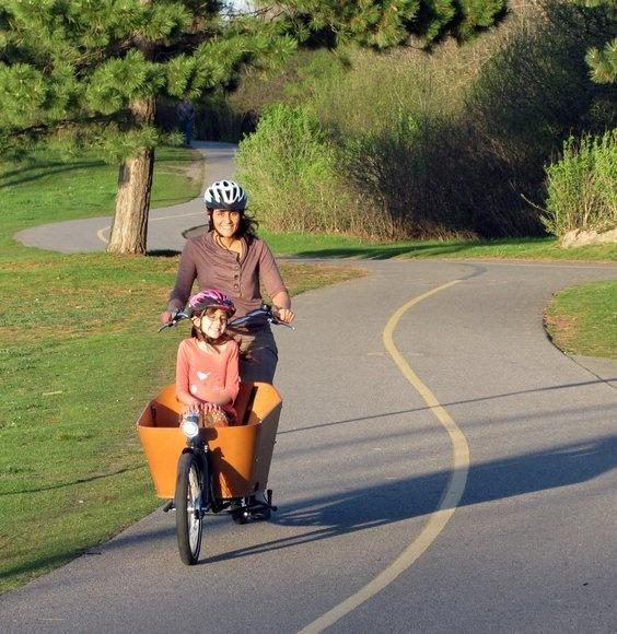 Anna Sierra gets a lift with mom Kathleen Wilker in the Babboe Bakfiets along the Ottawa River in Ontario.  Photo by Derek Heffernan