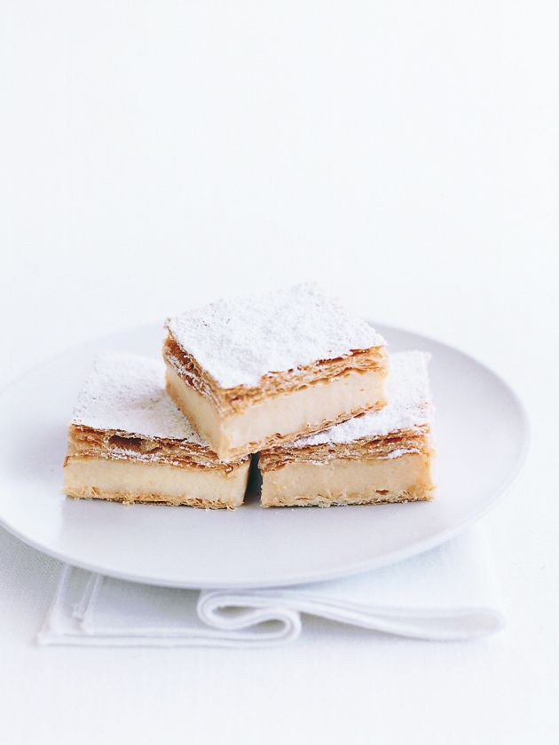 vanilla slice 375g ready-prepared puff pastry, thawed icing (confectioner's) sugar for dusting vanilla cream 1½ cups (375ml) milk 1½ cups (375ml) single (pouring) cream 60g butter 2 teaspoons vanilla extract ⅔ cup (150g) caster (superfine) sugar ⅓ cup cornflour (cornstarch) ½ cup (125ml) water 6 egg yolks