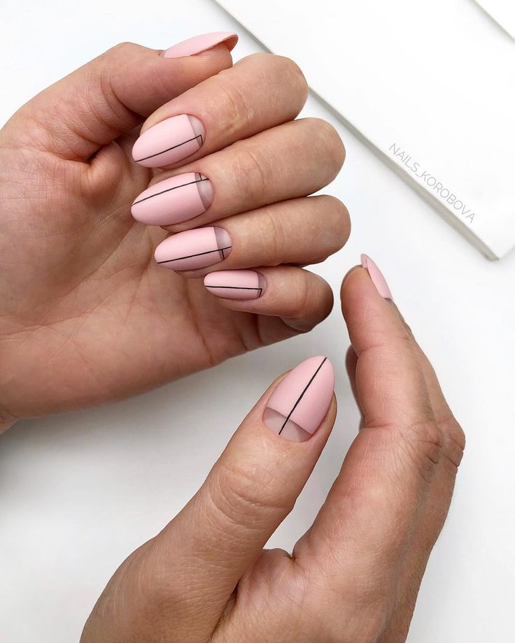 Matte pink nails with thin black line art and negative space design.. ― re-pin…
