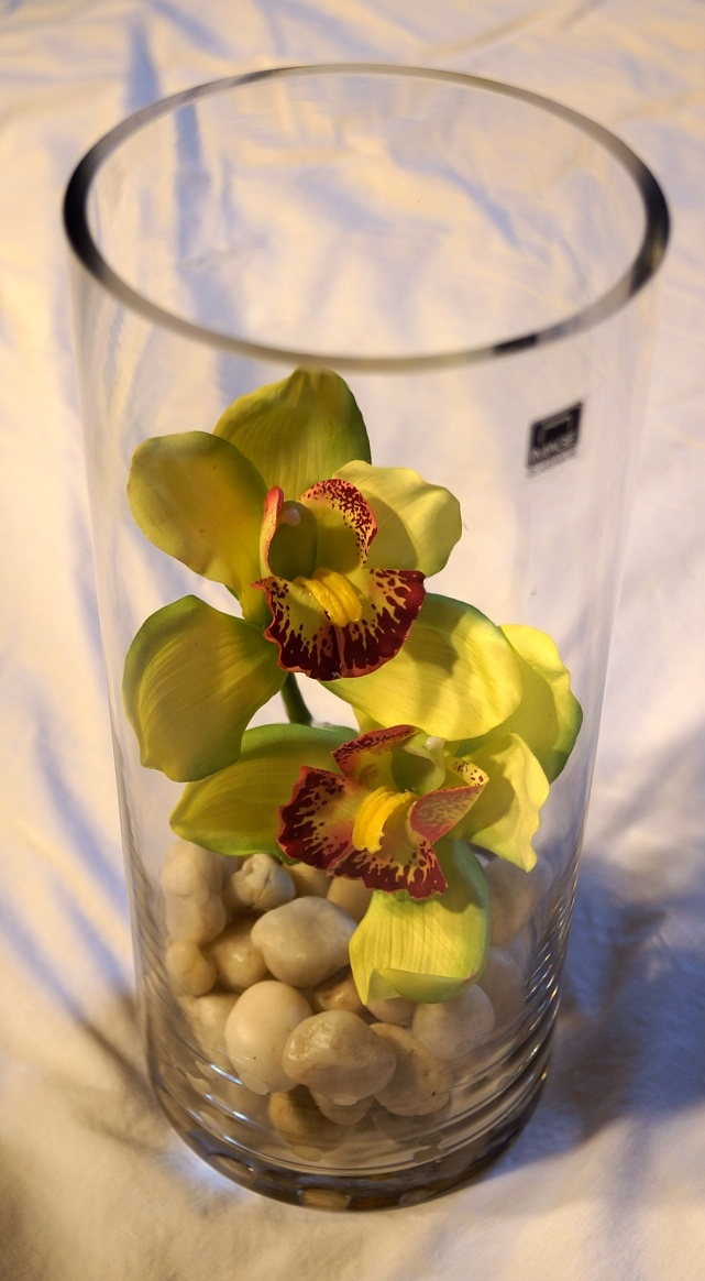 Tall Vase with Whitish Rocks & Green Orchids  $30.00