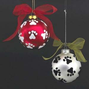 """Paw Prints on Silver Glass Ball Ornament, from Dogstuff.com. Decorate your tree with a touch of puppy love! Silver ball ornament has black paw prints around it. Ball is 3.15"""" in diameter."""