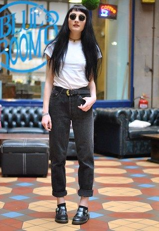 """Classic Levi's 550 denim mum jeans in a faded black colour. Great vintage condition. Our model is a UK 6 and 5ft 7"""" tall. She wears a UK 8 in the photo."""