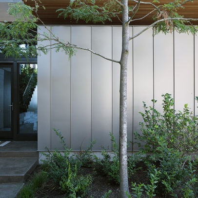 garden - standing seam metal roofing panel as a privacy panel